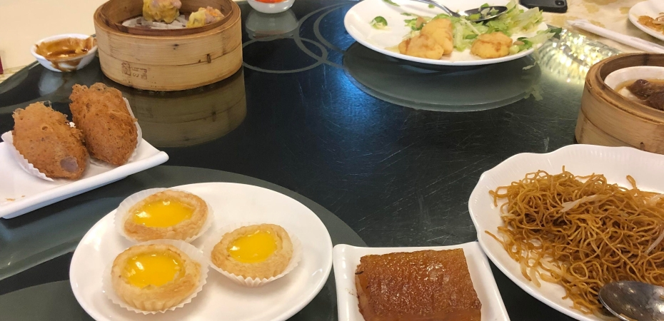 Taro puffs, shumai, egg custard tarts, water chestnut cake, salt and pepper tofu, noodles, and the edge of our dish of short ribs going from left to right.